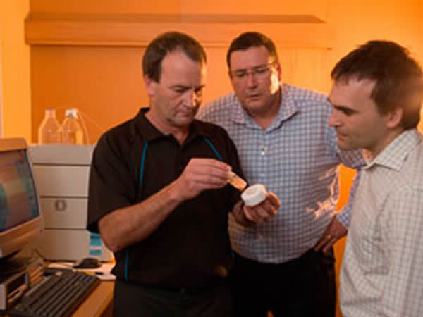 Terry Smith, John Luxton and Nigel Slaughter looking at a sample of the novel polymers